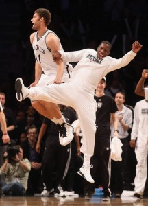 Brook Lopez and Tyshawn taylor celebrate