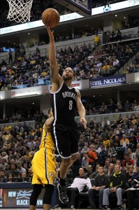 Deron Williams drives on Pacers