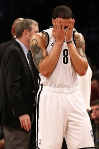 Deron Williams wipes face in jersey vs Bulls