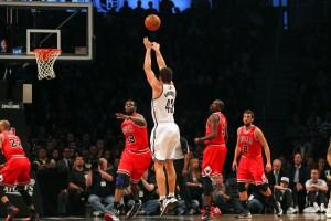 Kris Humphries shoots a jumper over the Bulls