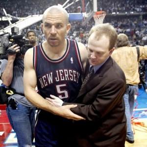 Lawrence Frank helping Jason Kidd off court