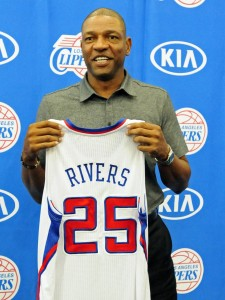 Rivers holding Clippers jersey