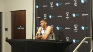 Lopez at podium at Nets media day