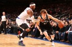 Andrei-Kirilenko-drives-past-Knicks-Carmelo-anthony
