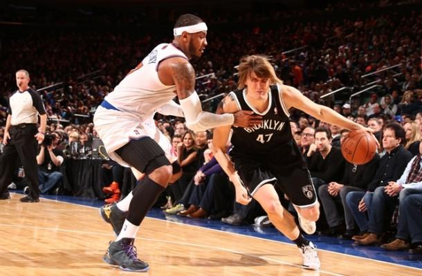 Andrei-Kirilenko-drives-past-Knicks-Carmelo-anthony