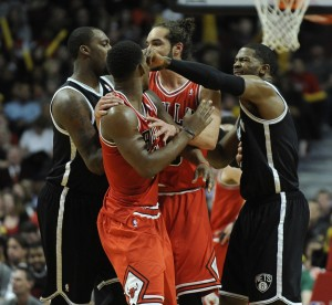 Joe Johnson pokes Bulls Jimmy Butler in the face during the game