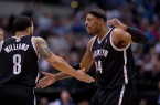 Paul-Pierce-celebrates-with-Deron-Williams1