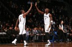 Andray Blatche kevin Garnett high five on the court