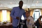 Andray Blatche holding Brooklyn jersey with Philippines coach