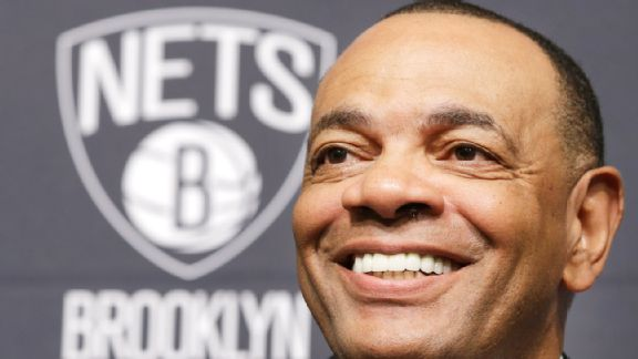 Lionel Hollins closeup with log behind