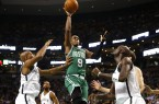 Celtics Rajon Rondo with layup through 3 Nets players