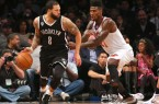 Deron Williams dribbles with Knicks Iman Shumpert guarding him