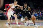 Joe Johnson drives past Pistons Kyle Singler