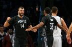Timberwolves Nikola Pekovic high fives teammates after destroying Brook Lopez