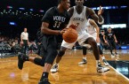 Thaddeus Young Wolves drives past Nets Kevin Garnett